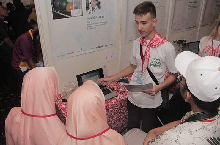 Insaf Salakhov, aged 16, explains his innovation to the Jury Board in IYIA 2018