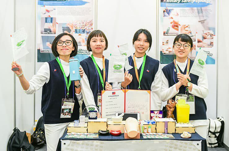 Female Inventors Displaying their innovative products